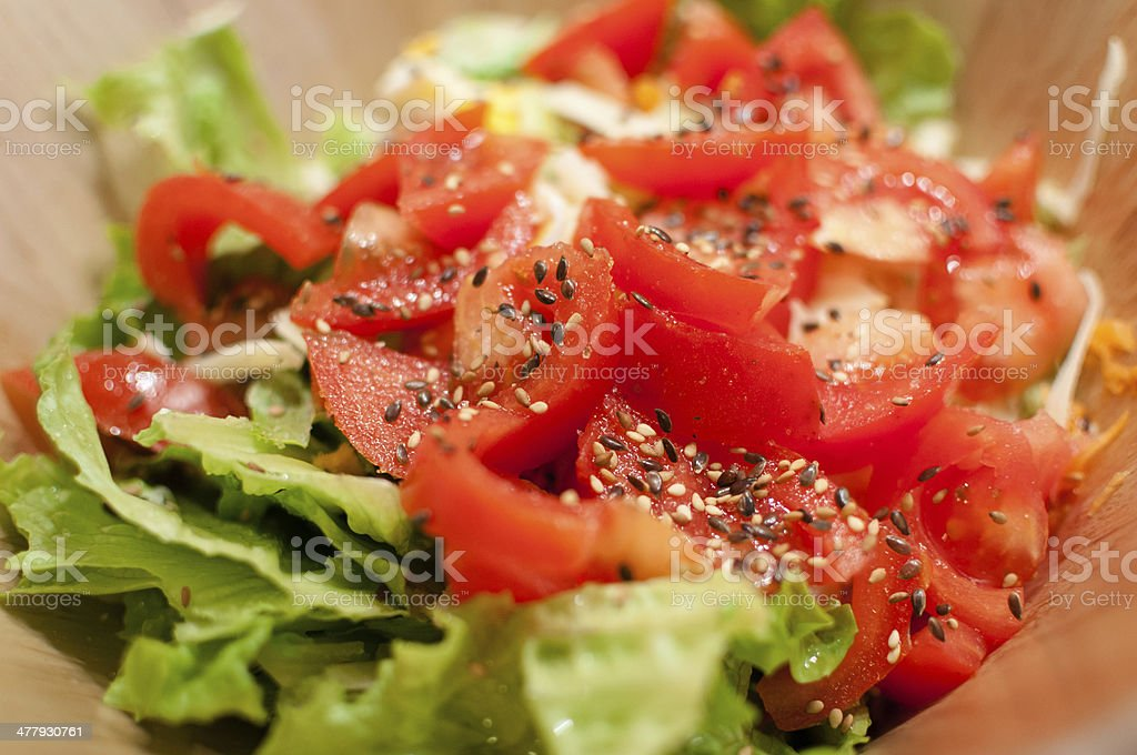 Close-up of fresh homemade tomato and lettuce salad stock photo