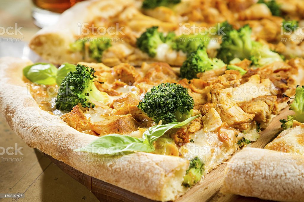 Closeup of fresh pizza with broccoli, chicken and cheese royalty-free stock photo