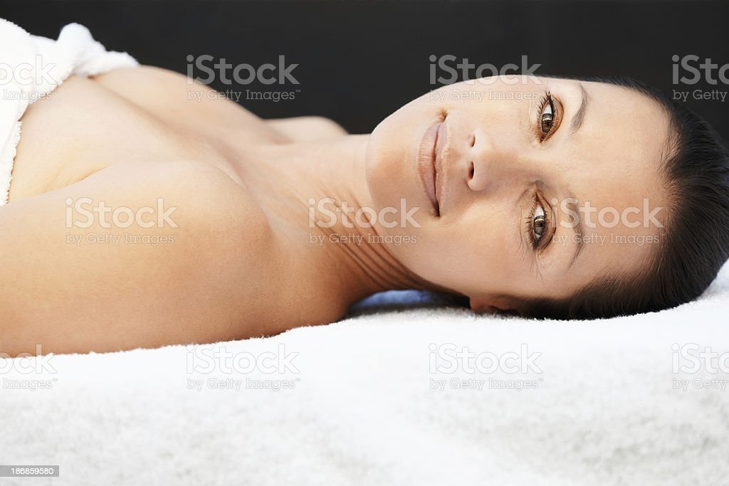 Closeup of fresh relaxed woman lying on massage table royalty-free stock photo