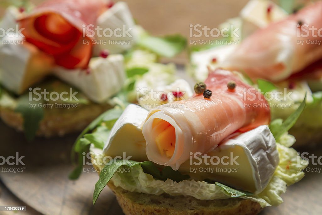 Closeup of fresh sandwiches with parma ham and camembert royalty-free stock photo