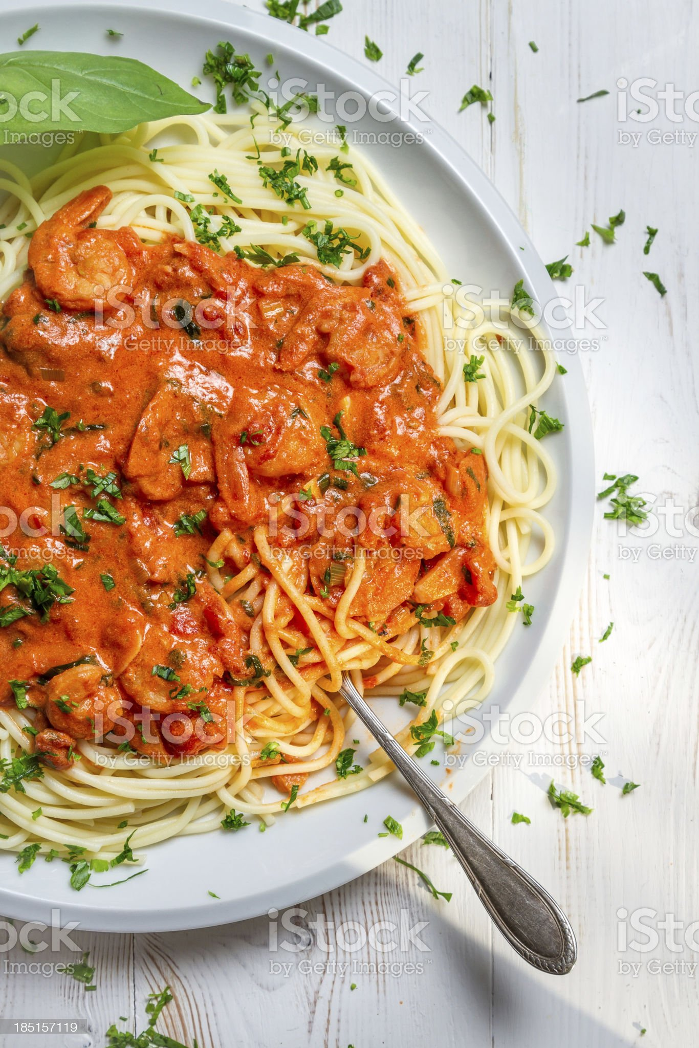 Closeup of fresh spaghetti with prawns and tomato sauce royalty-free stock photo
