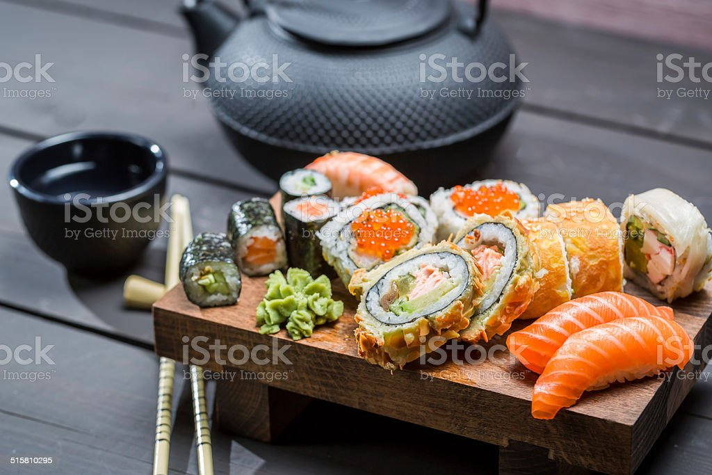 Closeup of fresh sushi on wooden board royalty-free stock photo