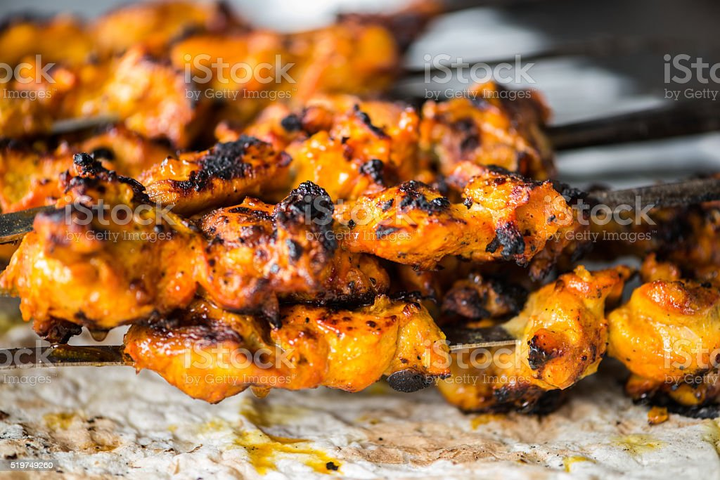Closeup of Freshly Grilled Chicken Tikka Masala Kebabs on Skewers stock photo