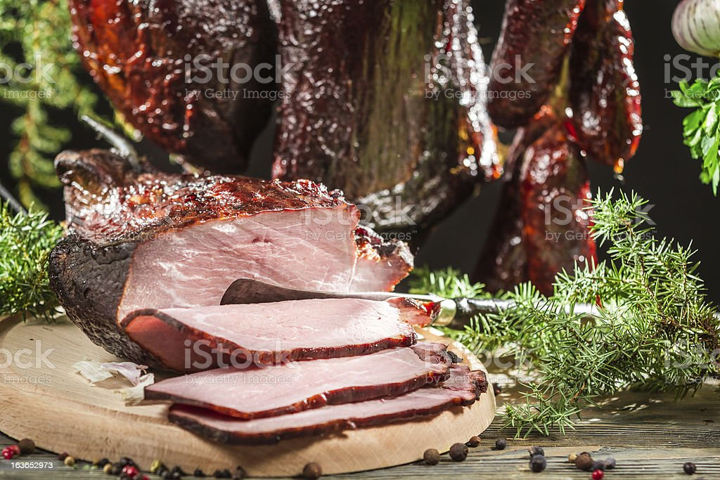 Closeup of freshly smoked ham in a rural smokehouse royalty-free stock photo