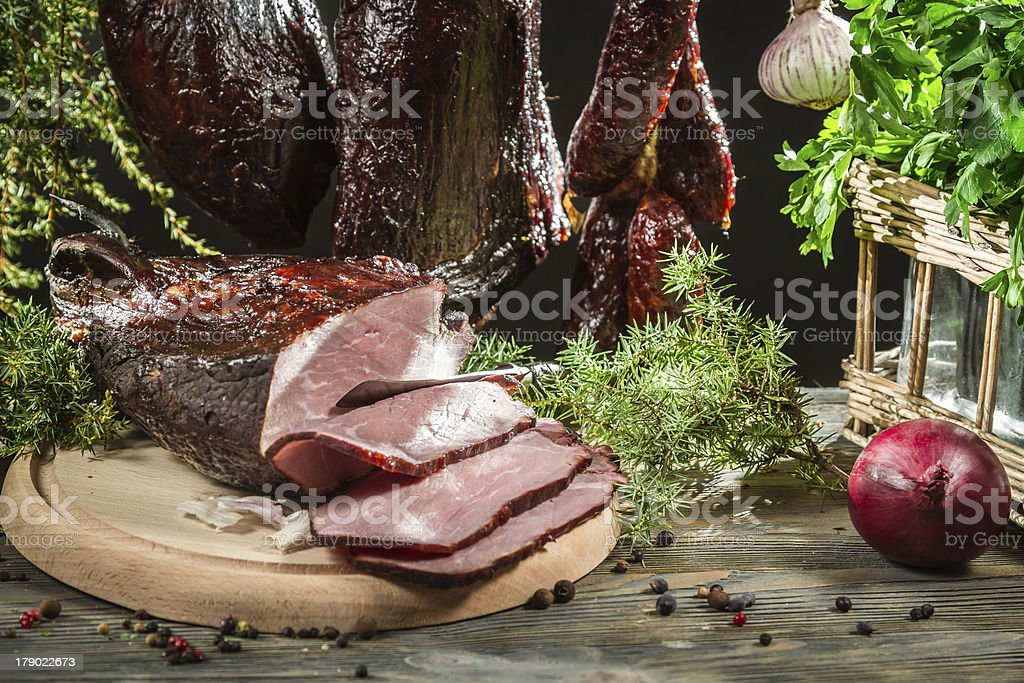 Closeup of freshly smoked ham in a rural smokehouse royalty-free stock photo