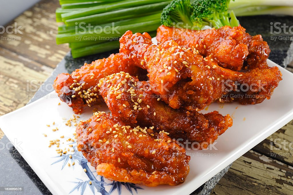 Close-up of fried chicken wings sprinkled with sesame stock photo