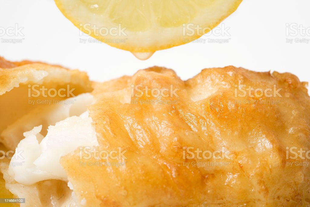 Close-up of fried fish with lemon on it stock photo