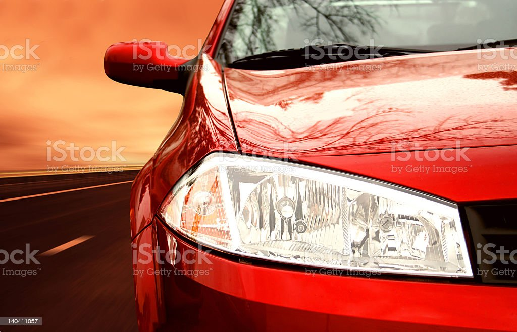 Close-up of front of red sports car on a highway royalty-free stock photo