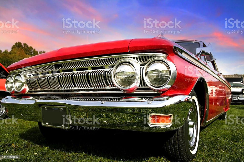 Close-up of front of shiny red muscle car stock photo