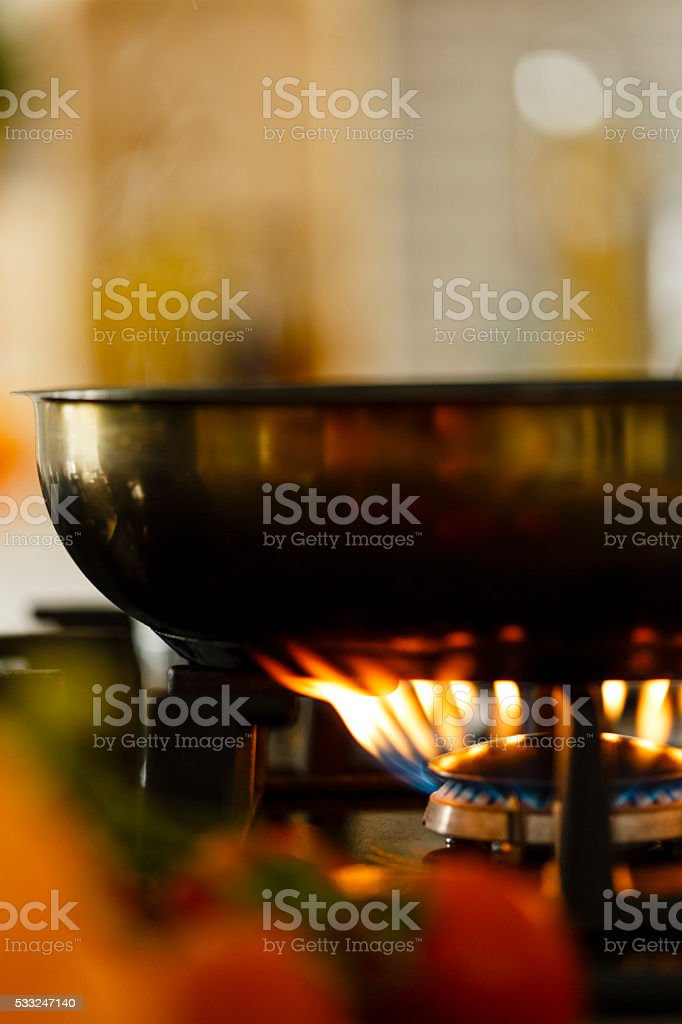 Close-up of frying pan on gas stove stock photo