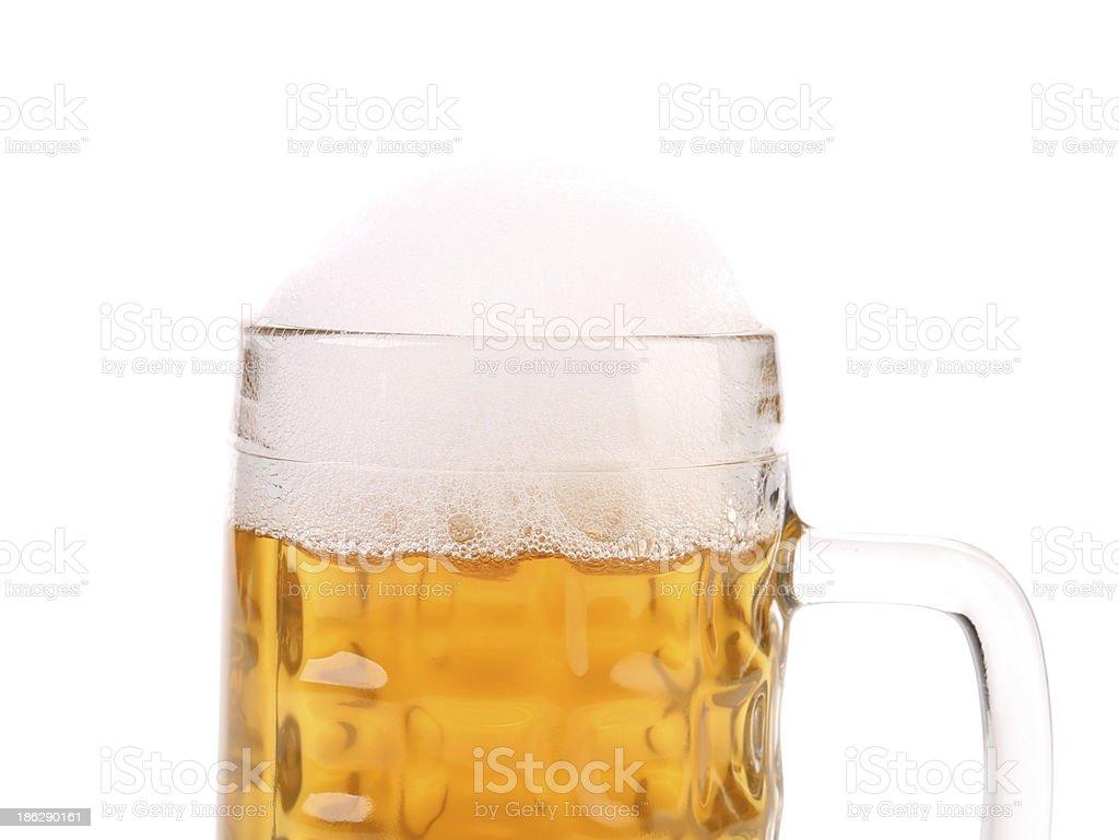 Closeup of full mug with beer foam. royalty-free stock photo
