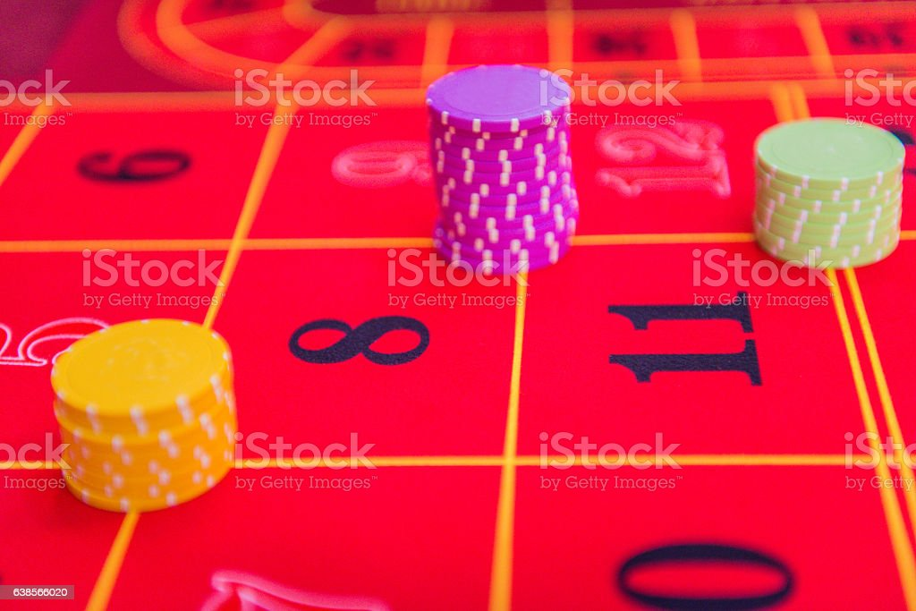 Close-up of Gambling Chips on Roulette Table at Casino, Europe stock photo