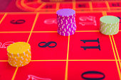 Close-up of Gambling Chips on Roulette Table at Casino, Europe