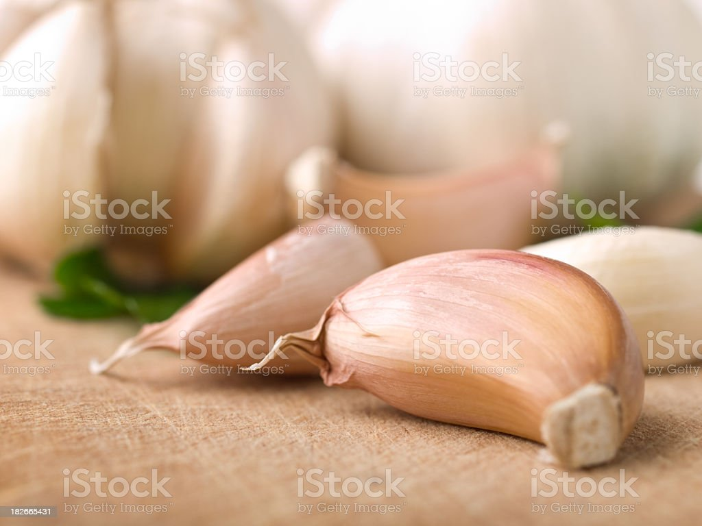 Close-up of garlic cloves laying on a table stock photo