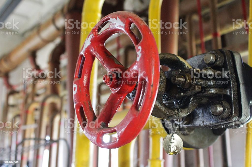 Close-up of gate valve red hand-wheel stock photo