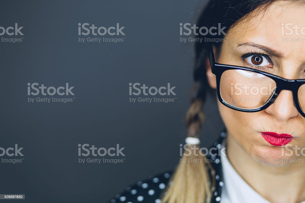 Closeup of Geeky Woman Making Silly Face stock photo
