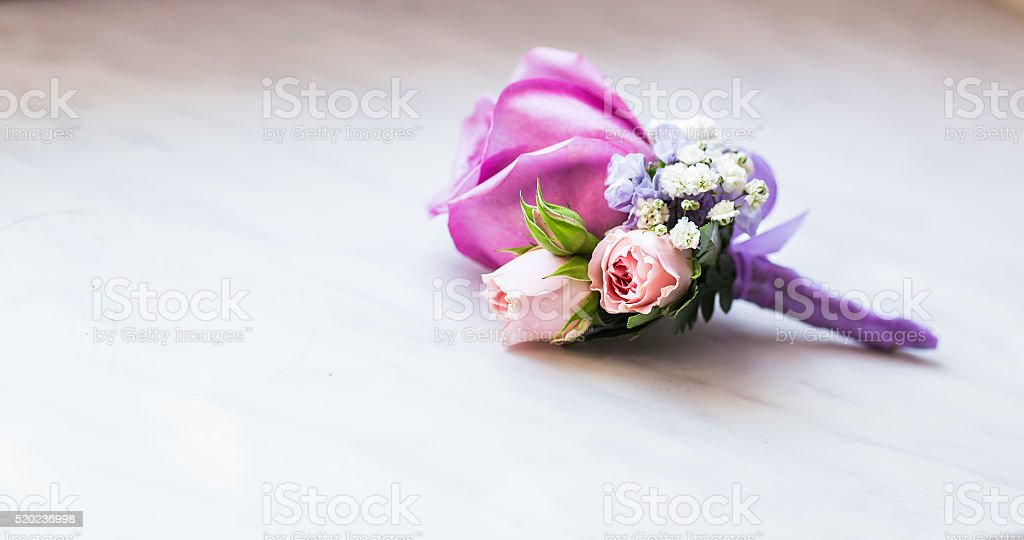 close-up of  Gentle groom's boutonniere stock photo