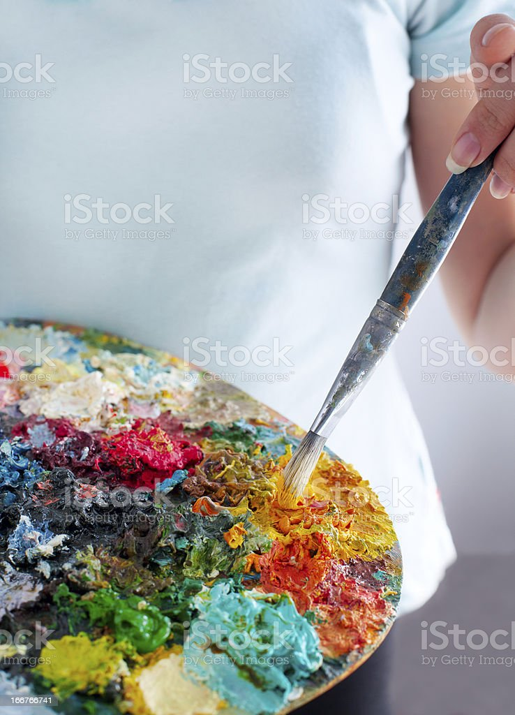 Closeup of girl holding brushes and palette royalty-free stock photo