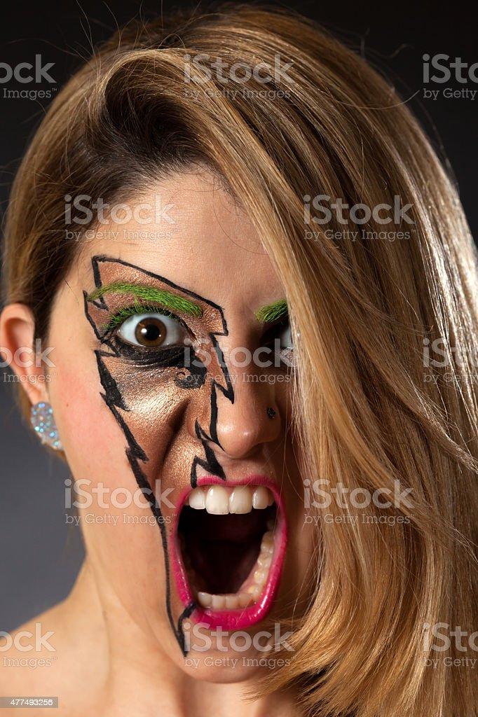 Closeup of Girl Screaming Lightning Makeup stock photo