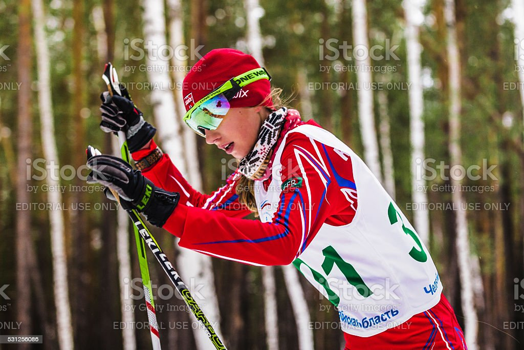closeup of girl skier in woods stock photo