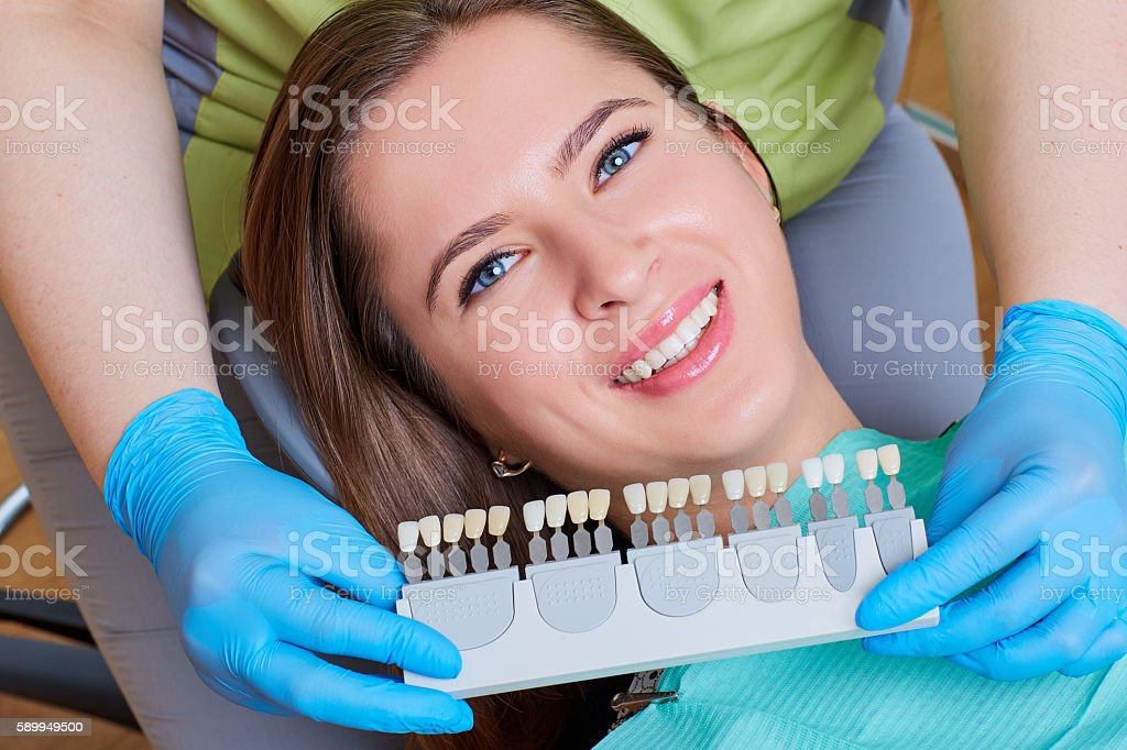 Close-up of  girl with a beautiful smile at the dentist. stock photo