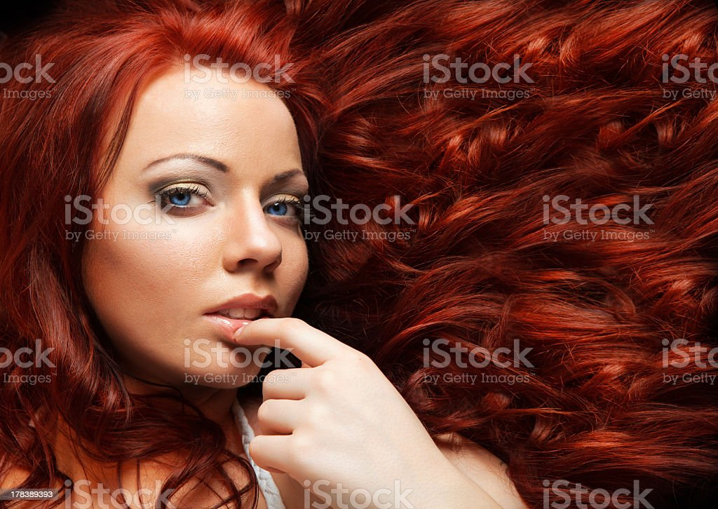 Close-up of girl with elegant make-up and healthy red hair stock photo