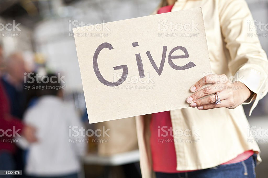 Closeup of Give sign at a donation center royalty-free stock photo