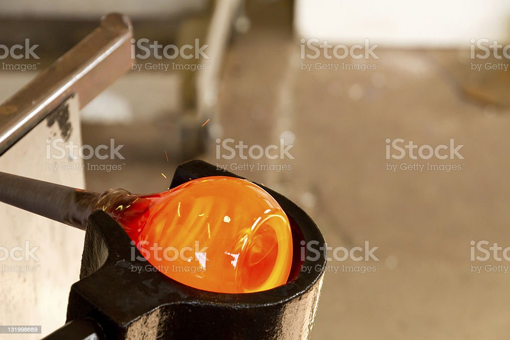 Close-up of glass blowing being performed royalty-free stock photo