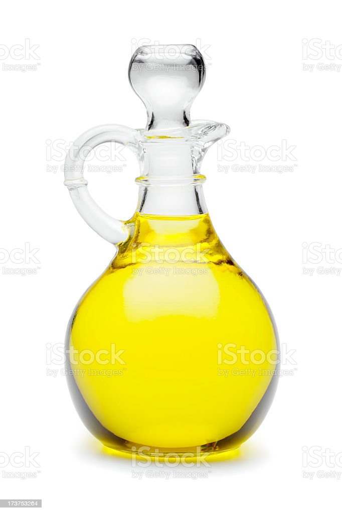 Close-up of glass jug of vegetable oil stock photo