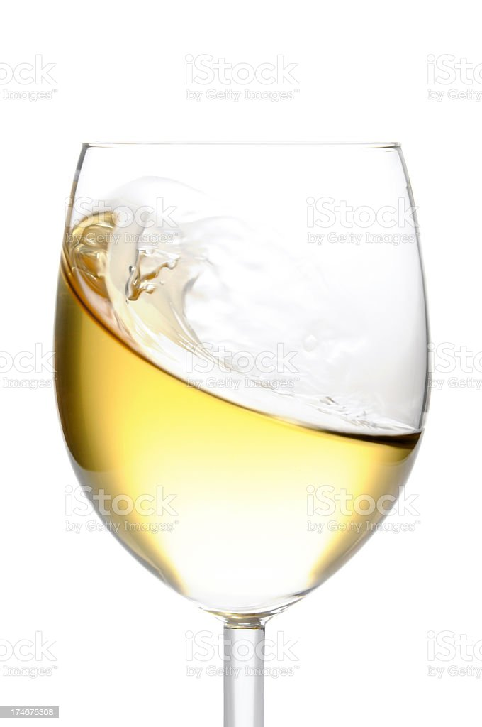 Close-up of glass of white wine isolated on white background stock photo