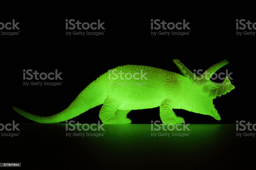 Close-up of glowing dinosaur stock photo