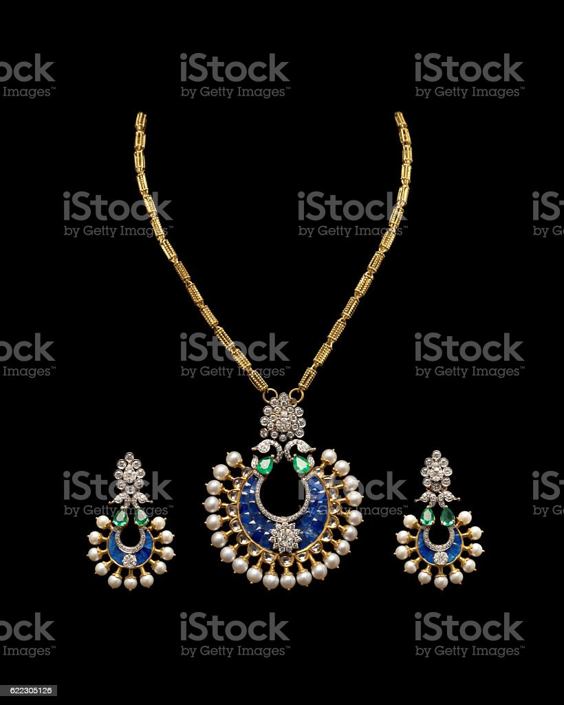 Close-up of Gold and Diamond necklace with earrings. stock photo