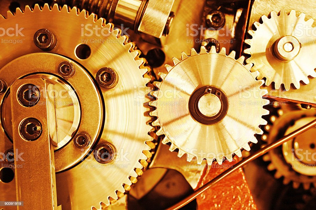 Close-up of gold colored gears royalty-free stock photo