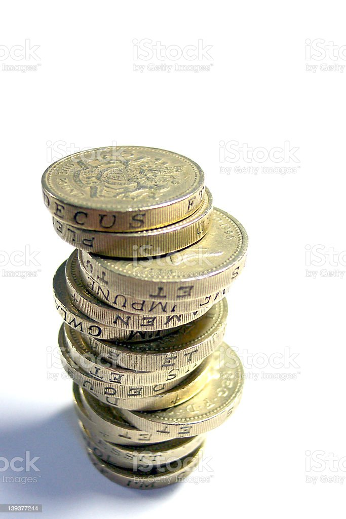 Close-up of gold pound stacked coins stock photo