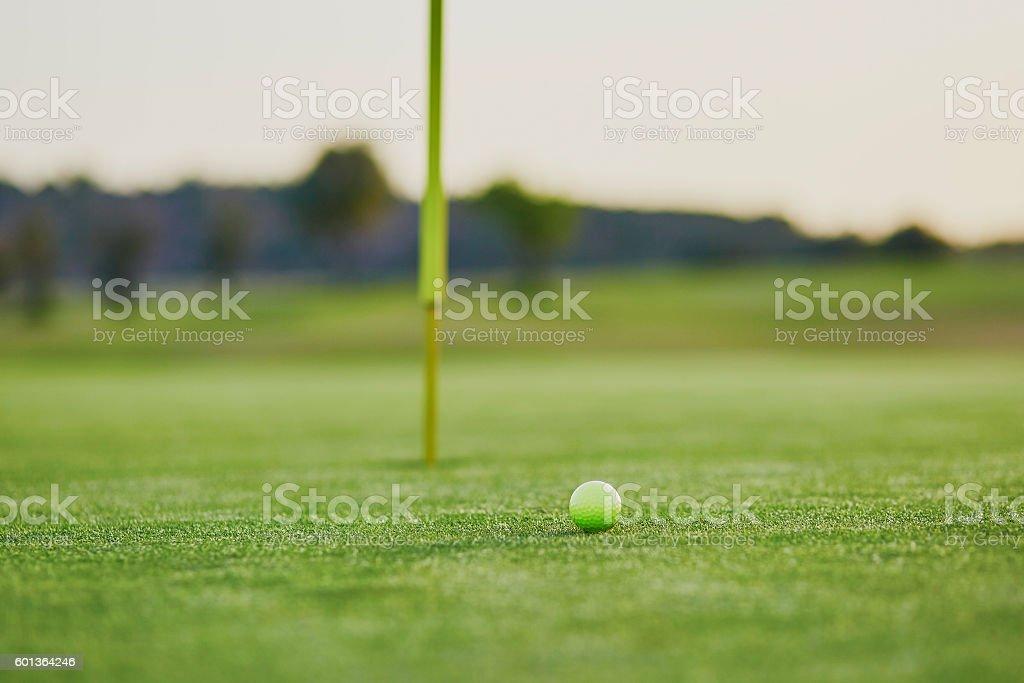 Closeup of golf ball on green stock photo