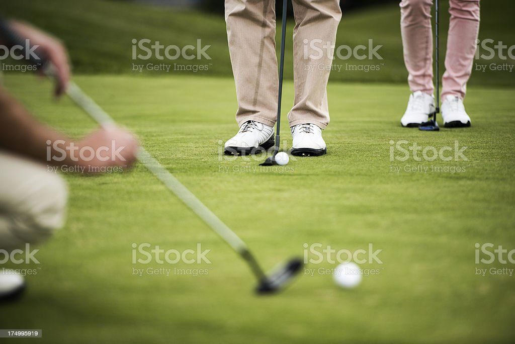 Close-up of golfer putting royalty-free stock photo