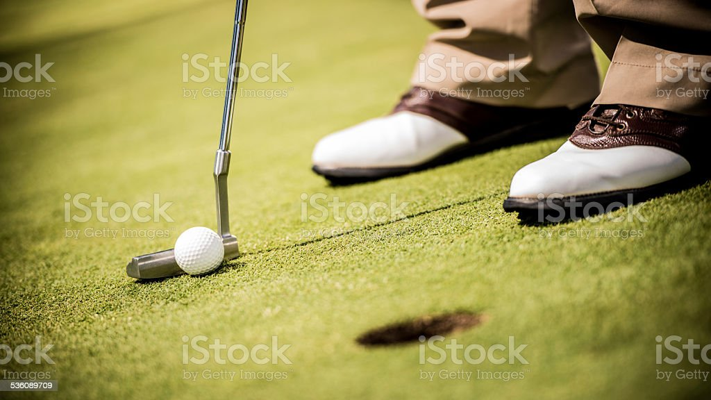 Close-up of Golfer Putting stock photo