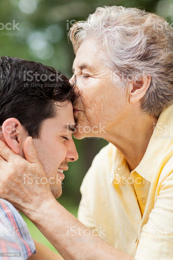 Close-up of grandmother kissing her grandson royalty-free stock photo