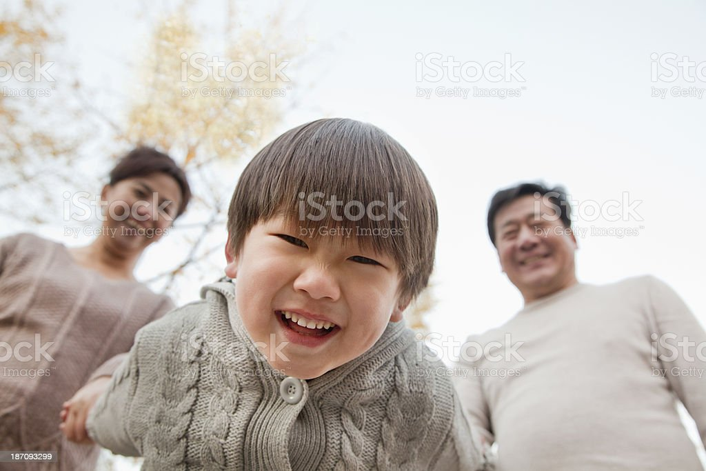 Close-Up Of Grandson Leaning into Camera royalty-free stock photo