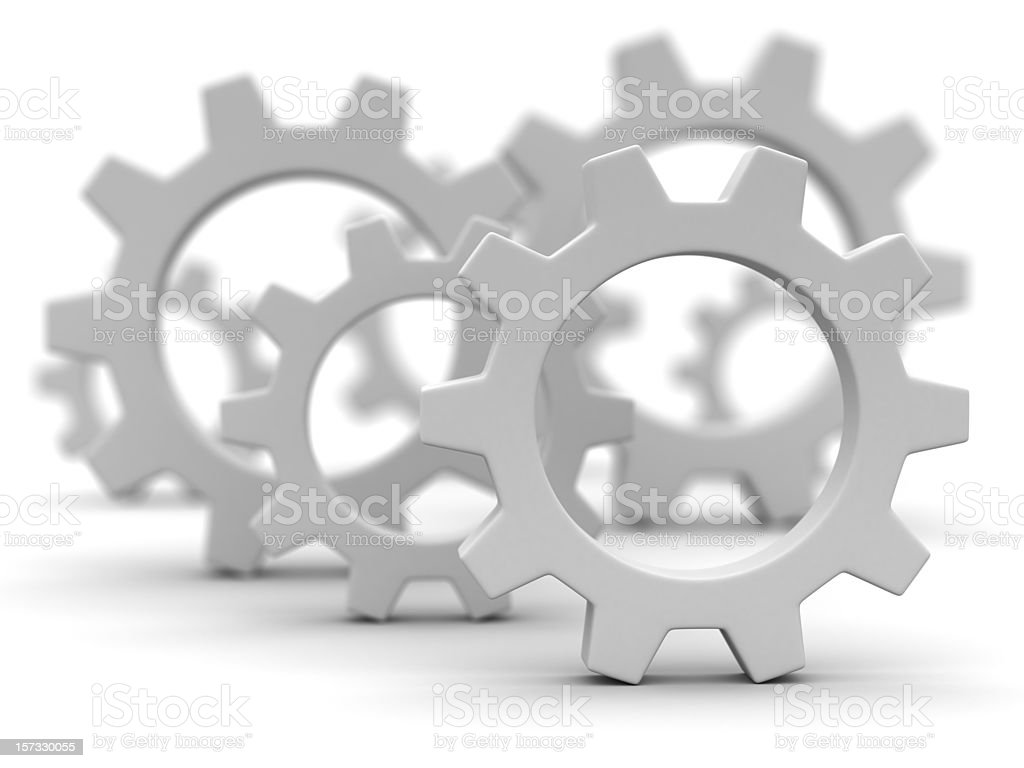 Close-up of gray gearwheels on white background stock photo