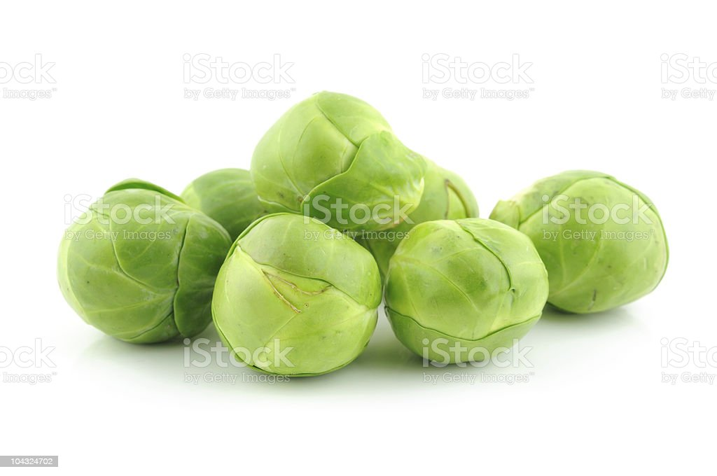 Close-up of green brussel sprouts isolated on white stock photo