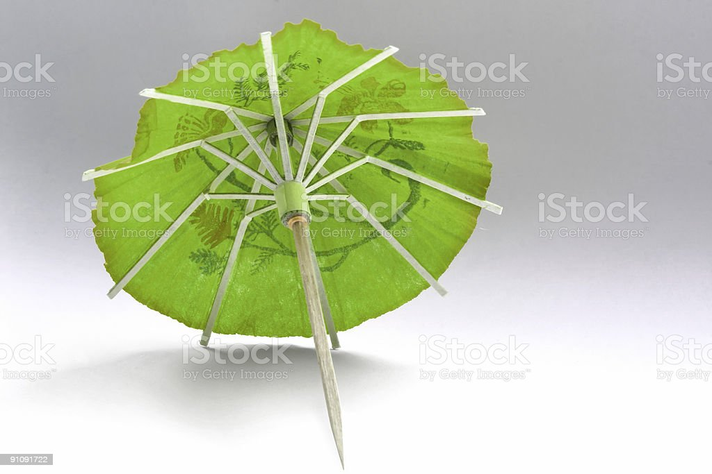 close-up of green cocktail umbrella royalty-free stock photo