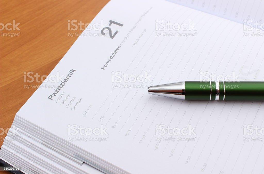 Closeup of green pen on calendar stock photo