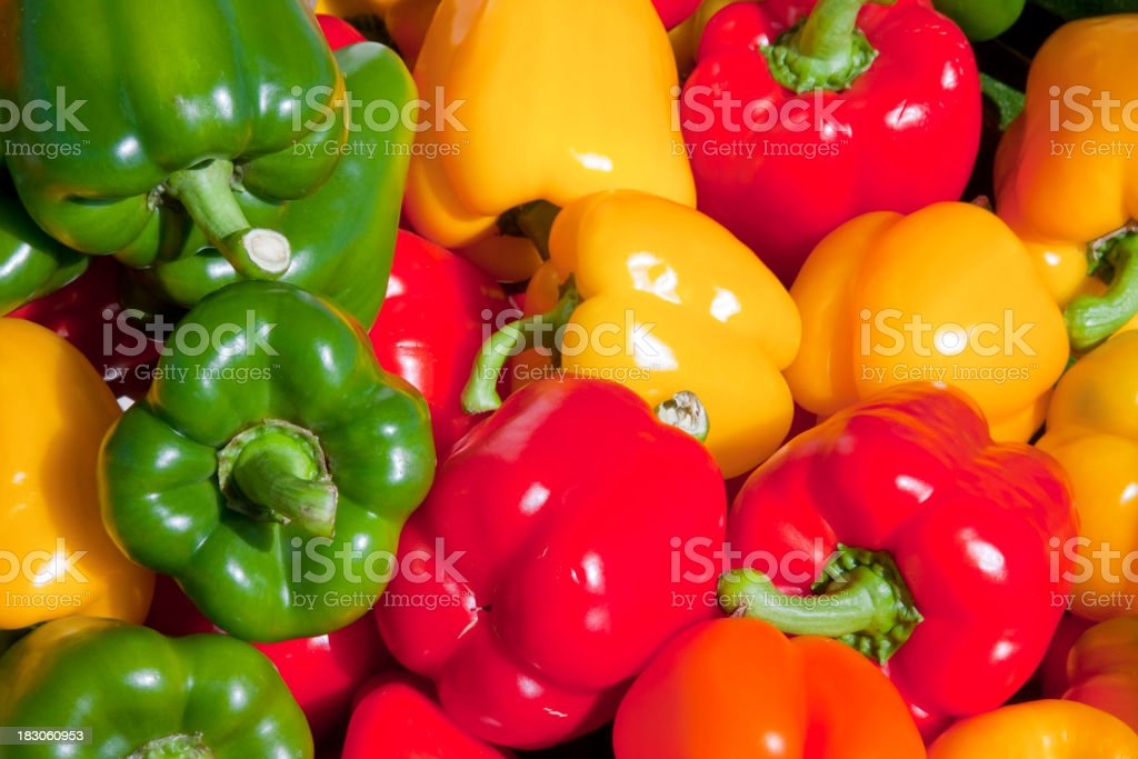 Close-up of green, red and orange bell peppers stock photo