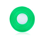 Closeup of green  ribbon roll over white background