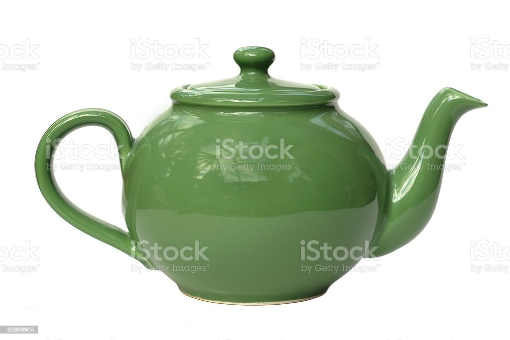 Close-up of green teapot isolated on white background royalty-free stock photo