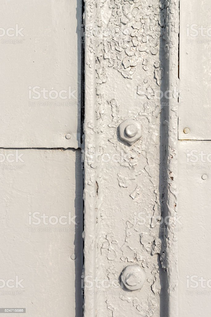 Closeup of Grey Painted Bolt and Metal stock photo