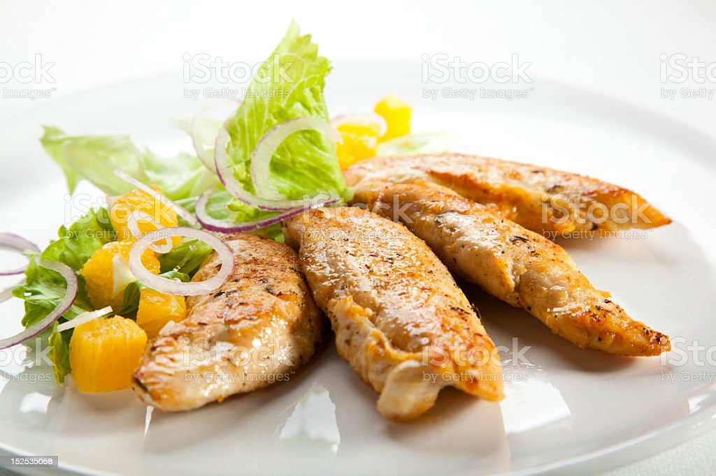 Close-up of grilled chicken meat and vegetables royalty-free stock photo