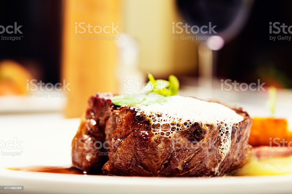 Close-up of grilled fillet steak with foam garnish in restaurant stock photo
