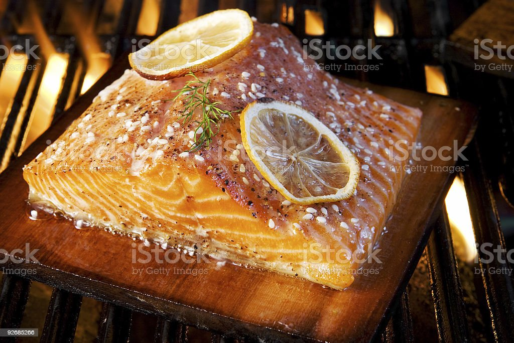 Closeup of grilled salmon and lemon royalty-free stock photo